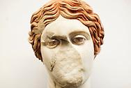 Ercolano, Italia - 23 novembre 2012. Un raro esempio di una statua di età romana che ha conservato la i dettagli della pittura usata per dipingere gli occhi all'interno di un deposito del sito archeologico di Ercolano (Herculaneum). Il sito archologico di epoca romana, patrimonio dell'Unesco, distante solo pochi km da Pompei, ha riportato alla luce tesori antichi di inestimabile valore. A differenza di Pompei, ad Ercolano sono stati ritrovati reperti organici ed in legno che hanno permesso agli archeologi di studiare in modo più approfondito le abitudini dell'epoca. Ph. Roberto Salomone Ag. Controluce.ITALY - A rare staue that has preserved its original oainting in the eyes is seen in a lab inside the archeological site of Herculaneum on November 23, 2012. The world heritage site of roman age, just a few miles away from Pompeii has brought to life treasures that made it possible for archeologists to study in a more detailed way the lifestyle of ancient romans.