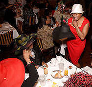 Helen Jones-Kelley of Clayton (right) sports the derby hat she got in the silent auction during the Derby Day Brunch, benefiting the Kettering Wellness Center, held at the Brio Tuscan Grille in the Greene, Saturday, May 1, 2010.