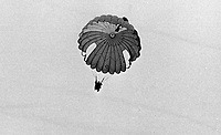 Mary Peters, N Ireland, Olympic Gold Medallist, women's pentathlon, glides serenely to earth in her first ever parachute jump from a light aircraft over Newtownards Airport, Co Down, N Ireland. 26h November 1974. 197411260667d<br /> <br /> Copyright Image from Victor Patterson, 54 Dorchester Park, <br /> Belfast, UK, BT9 6RJ<br /> <br /> t1: +44 28 9066 1296 (from Rep of Ireland 048 9066 1296)<br /> t2: +44 28 9002 2446 (from Rep of Ireland 048 9002 2446)<br /> m: +44 7802 353836<br /> <br /> e1: victorpatterson@me.com<br /> e2: victorpatterson@gmail.com<br /> www.victorpatterson.com<br /> <br /> Please see my Terms and Conditions of Use at www.victorpatterson.com. It is IMPORTANT that you familiarise yourself with them.<br /> <br /> Images used on the Internet must be visibly watermarked i.e. © Victor Patterson<br /> within the body of the image and copyright metadata must not be deleted. Images <br /> used on the Internet have a size restriction of 4kbs and will be chargeable at current<br />  NUJ rates unless agreed otherwise.<br /> <br /> This image is only available for the use of the download recipient i.e. television station, newspaper, magazine, book publisher, etc, and must not be passed on to any third <br /> party. It is also downloaded on condition that each and every usage is notified within 7 days to victorpatterson@me.com<br /> <br /> The right of Victor Patterson to be identified as the author is asserted in accordance with The Copyright Designs And Patents Act (1988).