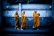 In Thailand, where 95 percent of the population is Buddhist, monks are responsible for preserving and conveying the teachings of the Buddha. Each morning, they walk from their monasteries to meet and offer blessings to lay Buddhists, who in turn place food and money in the alms bowls carried by the monks.