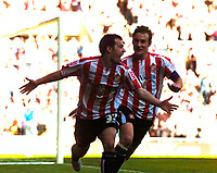 Photo: Jed Wee/Sportsbeat Images.<br /> Sunderland v Wolverhampton Wanderers. Coca Cola Championship. 07/04/2007.<br /> <br /> Sunderland's Ross Wallace (L) celebrates after scoring the winning goal, as Dean Whitehead joins in.