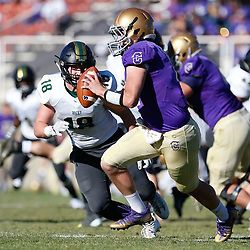 Carroll's Kolby Killoy is forced to scramble from Rocky's blitz during Saturday's game at Nelson Stadium. The Saints lost 42-21 to the Battlin' Bears.