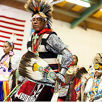 11031313    Brian Leddy<br /> Ryland Jim dances during a powwow Friday night in Ft. Defiance. The powwow was held in honor of Sister Marquerite Bartz.
