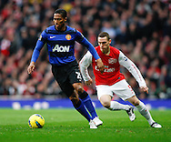 Picture by Andrew Tobin/Focus Images Ltd. 07710 761829. .21/01/12. Luis Antonio Valencia (25) of Manchester United on the ball during the Barclays Premier League match between Arsenal and Manchester United at Emirates Stadium, London.