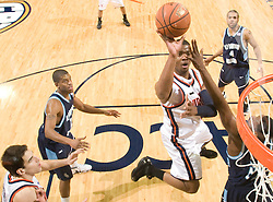 Virginia forward Jamil Tucker (12) shoots a jump shot against ODU.  The Virginia Cavaliers men's basketball team defeated the Old Dominion Monarchs 80-76 in the second round of the College Basketball Invitational (CBI) at the University of Virginia's John Paul Jones Arena in Charlottesville, VA on March 24, 2008.