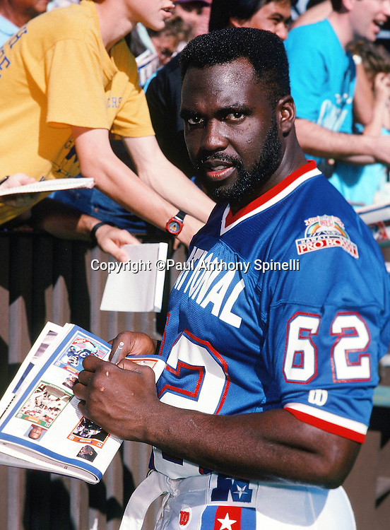 San Francisco 49ers offensive lineman Guy McIntyre (62) signs fan autographs on photo day during the week of the 1990 NFL Pro Bowl between the National Football Conference and the American Football Conference on Jan. 30, 1990 in Honolulu. The NFC won the game 27-21. (©Paul Anthony Spinelli)