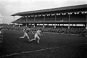 05/02/1967<br /> 02/05/1967<br /> 5 February 1967<br /> National Hurling League: Cork v Dublin at Croke Park, Dublin. <br /> Cork back, P. Doolan (2), chases Dublin's N. Kinsella with the ball.