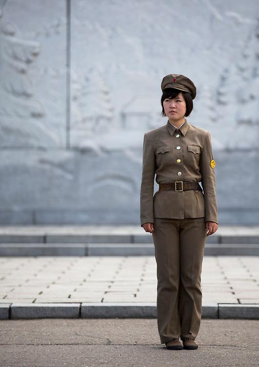 Female guard at Mansudae art studio in Pyongyang, North Korea.