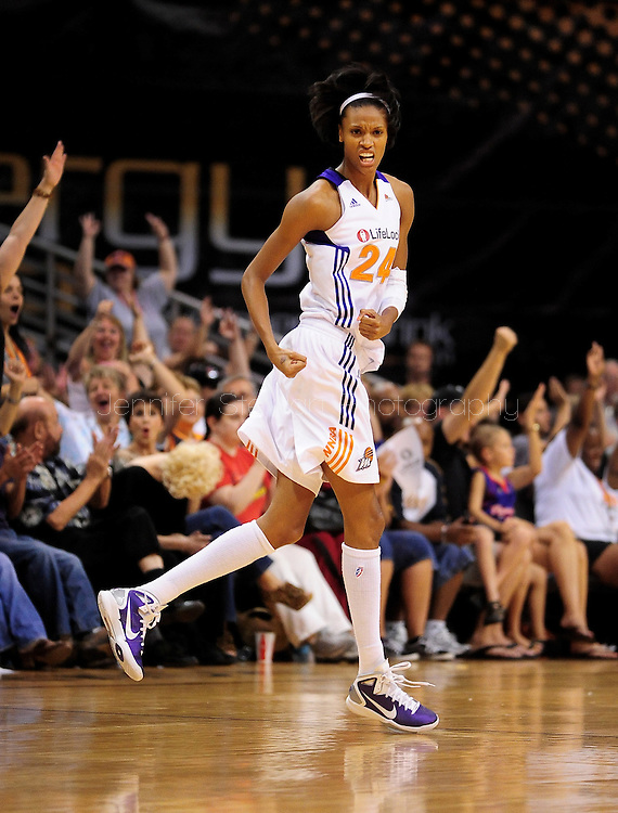 Sep 3, 2011; Phoenix, AZ, USA; Phoenix Mercury guard DeWanna Bonner (24)  reacts on the court against the Los Angeles Sparks at the US Airways Center.  The Mercury defeated the Sparks 93-77.  Mandatory Credit: Jennifer Stewart-US PRESSWIRE