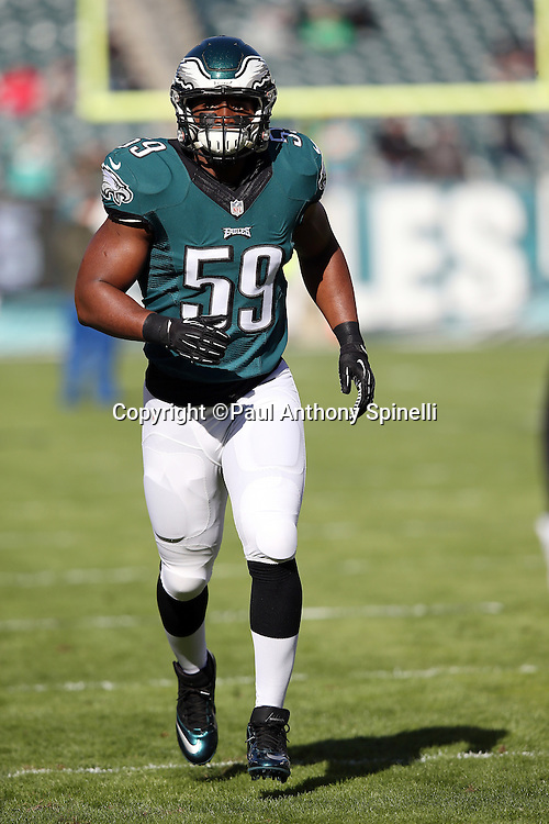 Philadelphia Eagles inside linebacker DeMeco Ryans (59) chases the action while warming up before the 2015 week 10 regular season NFL football game against the Miami Dolphins on Sunday, Nov. 15, 2015 in Philadelphia. The Dolphins won the game 20-19. (©Paul Anthony Spinelli)