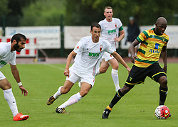 26.07.2015, Prien am Chiemsee, GER, Testspiel, FC Augsburg vs Norwich City, im Bild Christoph Janker (FC Augsburg #16, Mitte), Sebastien Bassong (Norwich City FC) // during the International Friendly Football Match between FC Augsburg and Norwich City in Prien am Chiemsee, Germany on 2015/07/26. EXPA Pictures © 2015, PhotoCredit: EXPA/ Eibner-Pressefoto/ Krieger<br /> <br /> *****ATTENTION - OUT of GER*****