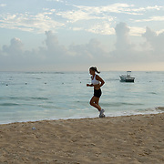 Woman jogging on the beach in Punta Cana