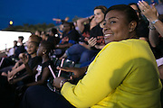 Mayor Lovely Warren watches the Red Wings game at Frontier Field in Rochester on Friday, July 31, 2015. Mayor Warren sat with students from School #17, who ate dinner at the stadium, and then camped on the field Friday night.