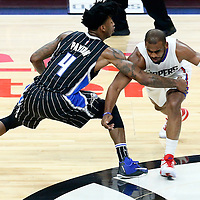 11 January 2017:` Orlando Magic guard Elfrid Payton (4) defends on `c3 during the LA Clippers 105-96 victory over the Orlando Magic, at the Staples Center, Los Angeles, California, USA.