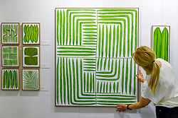 "© Licensed to London News Pictures. 05/10/2019. LONDON, UK. Artist Marianne Hendriks with one of her large scale works ""Labyrinth Magnum Uno"" at The Other Art Fair, presented by Saatchi Art.  120 international, independent artists are displaying their works to be sold direct to buyers.  The fair is taking place at Victoria House in Bloomsbury until 6 October 2019.  Photo credit: Stephen Chung/LNP"