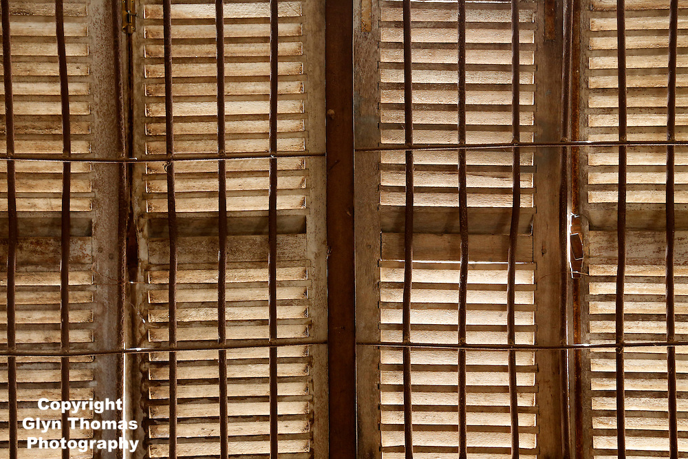 Window in a cell inside Tuol Sleng prison, now the Genocide Museum, Phnom Penh, Cambodia