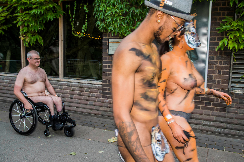 Participants included a man in a wheelchair and many disguised in full body paint - Naked runners take part in the ZSL London Zoo Streak for Tigers. They are raising money for tigers whose group name is, apparently, a streak.