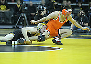 January 07, 2011: Iowa's Matt McDonough scores a takedown against Oklahoma State's Jon Morrison during the 125-pound bout in the NCAA wrestling dual between the Oklahoma State Cowboys and the Iowa Hawkeyes at Carver-Hawkeye Arena in Iowa City, Iowa on Saturday, January 7, 2012. McDonough won 14-4.