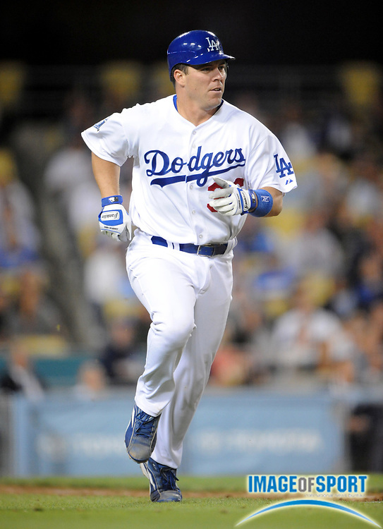 June 2, 2008; Los Angeles, CA, USA; Los Angeles Dodgers catcher Danny Ardoin (36) runs toward first base on a single in the seventh inning against the Colorado Rockies at Dodger Stadium.