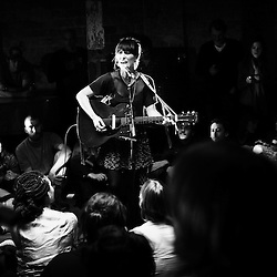 PARIS, FRANCE. OCTOBER 11, 2011. Folk-rock singer Feist playing in a parisian home for La Blogotheque, a music blog which aims at bringing musicians and their fans closer. Photo : Antoine Doyen