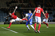 Peterborough United forward Aaron Williams (41) fouls Coventry City midfielder Romain Vincelot (4)  during the Sky Bet League 1 match between Peterborough United and Coventry City at London Road, Peterborough, England on 25 March 2016. Photo by Simon Davies.