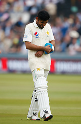 Pakistan's Babar Azam walks off as he retires hurt during day two of the First NatWest Test Series match at Lord's, London.