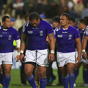 Dejected Samoan players at the end of the South Africa V Samoa, Pool D match during the IRB Rugby World Cup tournament. North Harbour Stadium, Auckland, New Zealand, 30th September 2011. Photo Tim Clayton...