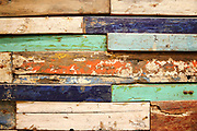Old, grunge wood panels of used colourful wood pieces