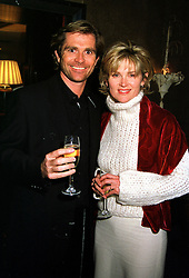TV presenter ANTHEA TURNER and her close friend MR GRANT BOVEY, at a party in London on 20th December 1999.MZZ 35