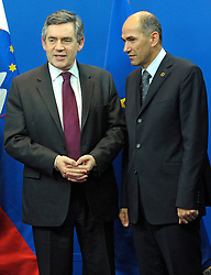 Gordon Brown, the UK's prime minister, left, is greeted by Janez Jansa, Slovenia's prime minister and standing president of the European Council, at the European Summit, in Brussels, Belgium on Thursday, June 19, 2008.  (Photo © Jock Fistick)