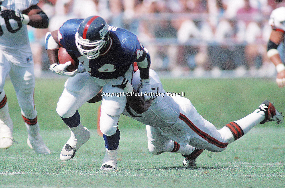 New York Giants fullback Kenyon Rasheed (89) tries to break a tackle as he runs the ball during the NFL preseason football game against the Cleveland Browns on Aug. 6, 1995 in Cleveland. The Giants won the game 19-13. (©Paul Anthony Spinelli)