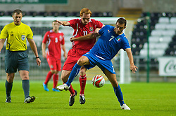 SWANSEA, ENGLAND - Friday, September 4, 2009: Wales' Shaun MacDonald tussles with Italy's Tommaso Bianchi (right) during the UEFA Under 21 Championship Qualifying Group 3 match at the Liberty Stadium. (Photo by Gareth Davies/Propaganda)