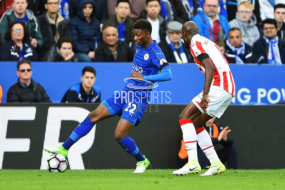 Leicester City midfielder Demarai Gray (22) holds off Stoke City defender Bruno Martins Indi (15) during the Premier League match between Leicester City and Stoke City at the King Power Stadium, Leicester, England on 1 April 2017. Photo by Jon Hobley.