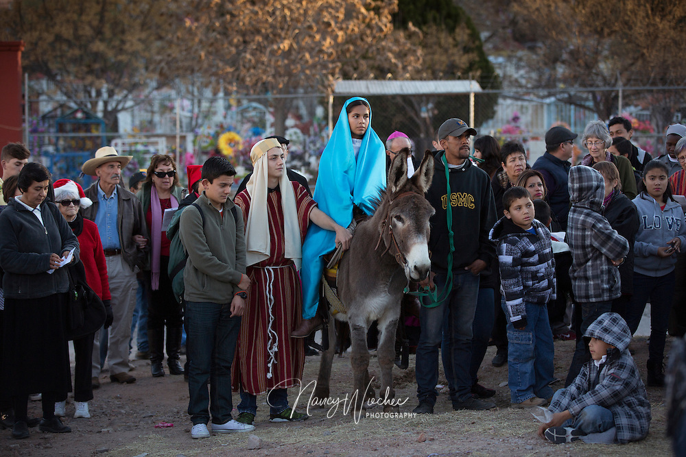 "People from the U.S. and Mexico take part in a ""posada,"" the commemoration of Mary and Joseph's search for shelter, Dec. 20 in Nogales, Sonora. The annual Nogales event held by the Kino Border Initiative and Dioceses Without Borders reflected on the struggles of migrants and migrant families. (CNS photo/Nancy Wiechec)(CNS photo/Nancy Wiechec)"