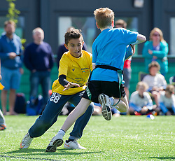 Children participate in tag rugby during the Bristol Sport Youth Festival - Photo mandatory by-line: Dougie Allward/JMP - Mobile: 07966 386802 - 06/06/2015 - SPORT - Multi-Sport - Bristol - SGS Wise Campus - Bristol Sport Festival Of Youth Sport - Festival Of Youth