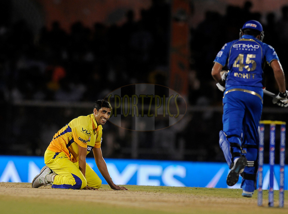 Ashish Nehra of The Chennai Superkings looks on as he fails to stop a ball of his own bowling during the eliminator match of the Pepsi Indian Premier League Season 2014 between the Chennai Superkings and the Mumbai Indians held at the Brabourne Stadium, Mumbai, India on the 28th May  2014<br /> <br /> Photo by Pal PIllai / IPL / SPORTZPICS<br /> <br /> <br /> <br /> Image use subject to terms and conditions which can be found here:  http://sportzpics.photoshelter.com/gallery/Pepsi-IPL-Image-terms-and-conditions/G00004VW1IVJ.gB0/C0000TScjhBM6ikg
