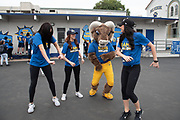 Los Angeles Rams mascot Rampage poses with cheerleaders during community improvement project at Belvedere Elementary School to upgrade play and social spaces around the school by building a new playground structure, painting murals and basketball backboards and landscaping., Friday, June 14, 2019, in Los Angeles, Calif. (Ed Ruvalcaba/Image of Sport)