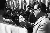 March 1973, Santiago, Chile --- President Salvador Allende shakes hands with the crowd during the last election campaign before his overthrow by Pinochet. --- Image by © Owen Franken/CORBIS - Photograph by Owen Franken