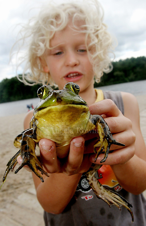 09/04/06 Milton, MA-- Marcel Stypulkowski, 5, of Braintree, shows off a bullfrog he named Darian, after his older brother who caught it at Houghton's Pond Sunday.  (090406frogsar01, saved in mon, Staff Photo by Angela Rowlings)