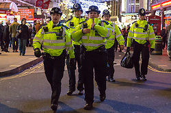 London, December 31 2017. Hundreds of police officers are on duty as revellers in London's West End enjoy the build-up to New Year. © SWNS