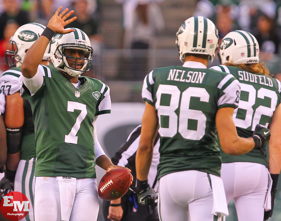 Dec 22, 2013; East Rutherford, NJ, USA; New York Jets quarterback Geno Smith (7) and New York Jets wide receiver David Nelson (86) celebrate the Jets 42-13 win over the Cleveland Browns at MetLife Stadium.