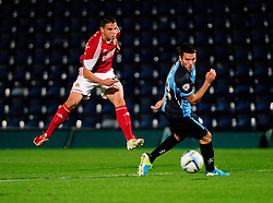 Bristol City's Stephen McLaughlin takes a shot at goal. - Photo mandatory by-line: Joe Dent/JMP - Tel: Mobile: 07966 386802 08/10/2013 - SPORT - FOOTBALL - London Road Stadium - Peterborough - Peterborough United V Brentford - Johnstone Paint Trophy