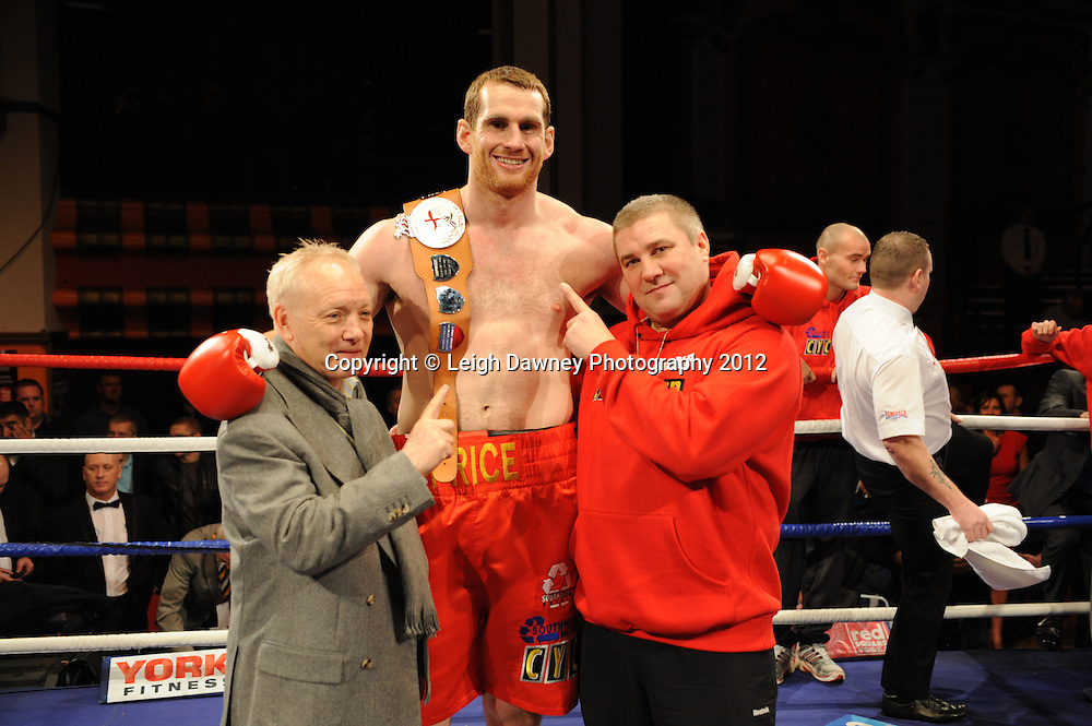 David Price with Frank Maloney (left) and trainer Franny Smith (right) celebrates after defeating John McDermott in 12x3 min contest to claim The British Heavyweight Title Eliminator at Olympia, Liverpool on the 21st January 2012. Referee Howard John Foster. Frank Maloney Promotions on Skysports HD1. © Leigh Dawney Photography 2012.