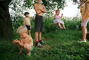 Children from Belarussia play in their yard. Soon they will be immigrating to Sacramento, CA.