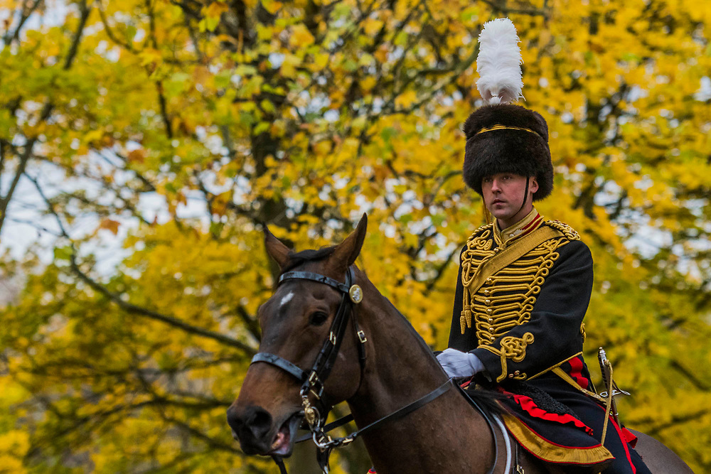 The guns are hooked up to the carriages again and led out of the park - The King's Troop Royal Horse Artillery (KTRHA), the ceremonial saluting battery of Her Majesty's Household Division, fire a 41-gun Royal Salute in honour of His Royal Highness The Prince of Wales's 69th birthday. 71 horses pulling six First World War-era 13-pounder Field Guns came into action from in the park halfway down Constitution Hill.  Each of the guns fired blank artillery rounds at ten-second intervals. London 14 Nov 2017