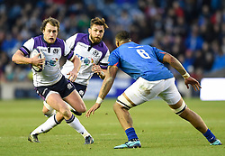 Scotland's Stuart Hogg side steps Samoa's Piula Faasalele during the Autumn International at BT Murrayfield, Edinburgh.
