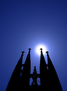 The sun behind one of the  spires on the unfinished Sagrada Familia church designed by Antonio Gaudi in Barcelona, Spain June 1998