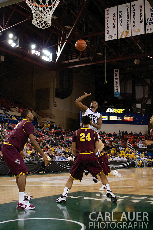 November 26th, 2010:  Anchorage, Alaska - Lindsey Hughey (15), a senior guard for Weber State floats a one handed shot up in the Wildcats 58-59 loss to Arizona State at the Great Alaska Shootout.