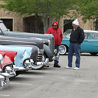 Gary Shemper, left, and Larry Henson both of Biloxi wander around and look at the all the different types of cars on display Friday at theannual Blue Suede Cruise.