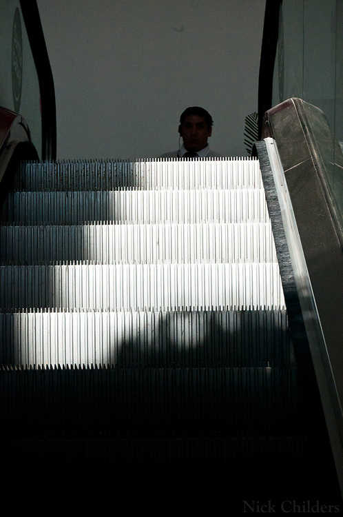 Santiago, Chile 2010<br /> <br /> A security guard waits at the top of an escalator at a store in the La Reina district two weeks after the 7.7 earthquake that struck just outside the capital of Santiago.